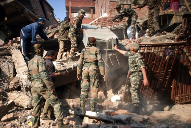 India Earthquake soldiers debris Imphal