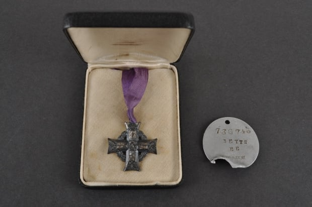 Canadian Memorial Cross and ID tag for Earl Betts