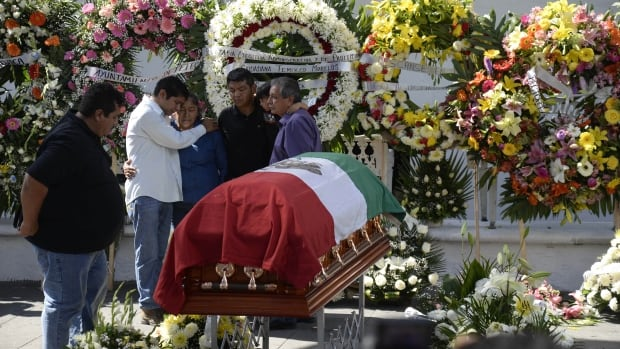Family members of Gisela Mota, the slain mayor of Temixco, Mexico, mourn next to her casket during a ceremony in her honour at the mayor's office on Sunday.