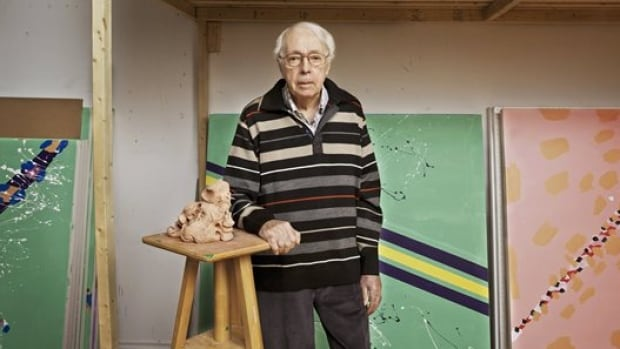 Marcel Barbeau seen in front of his some of his paintings in 2013.