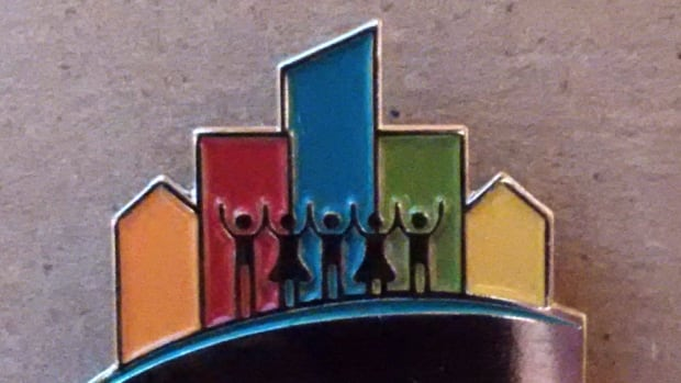 Six residents in Kitchener were given this pin for being named the inaugural city builder award winners.