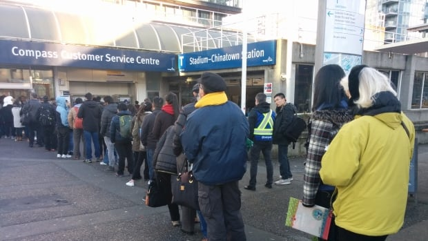 The lineup at the Compass Card Service Centre outside Stadium-Chinatown station extended to the curb around 2:45 p.m. on Monday.