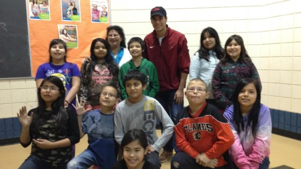 Christian Kowalchuk with kids in the baseball clinic in La Ronge, Sask.
