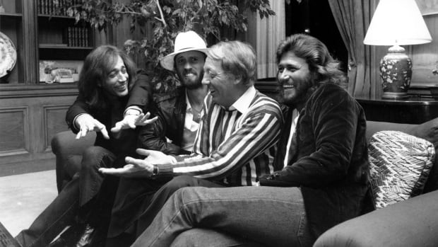 In this  May 8, 1981, file photo the Bee Gees, from left, Robin Gibb, Maurice Gibb and Barry Gib sit with Robert Stigwood, centre, in New York City.