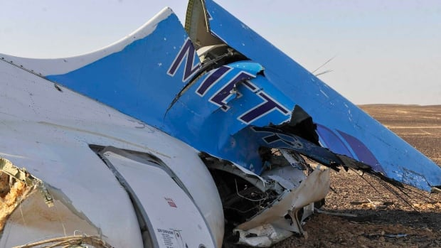 This photo released by the Prime Minister's office shows the tail of a Metrojet plane that crashed in Hassana, Egypt on Oct. 31.
