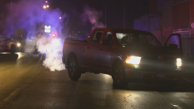 Police say the driver of this truck was shot at during a high-speed chase with three suspects in a white sedan.
