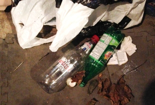 Empty vodka bottle at Kane house