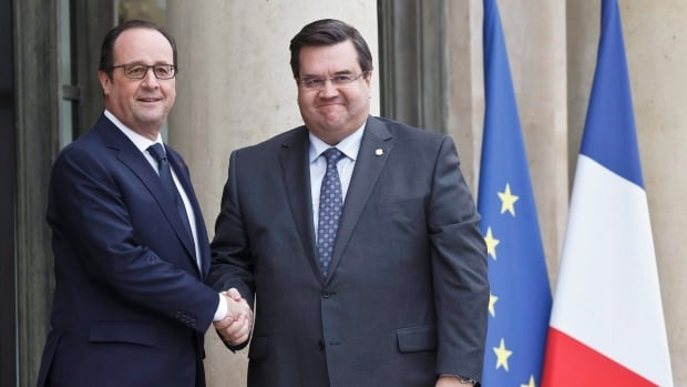 French President Francois Hollande, left, welcomes Montreal Mayor Denis Coderre, right, at the Elysee Palace in Paris, on Feb. 2, 2015. Coderre was on a three-days visit to France.