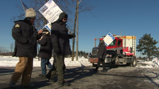 Off-duty correctional officers picket outside the Ottawa-Carleton Detention Centre to block the arrival of portable living quarters. The quarters are meant for managers as a contingency plan in case correctional officers strike on Sunday.