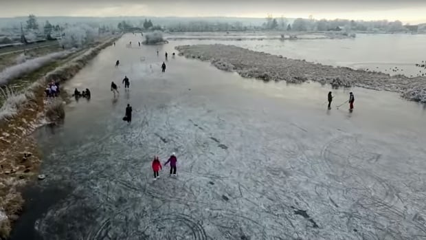 Skating on a frozen pond in Surrey, B.C.