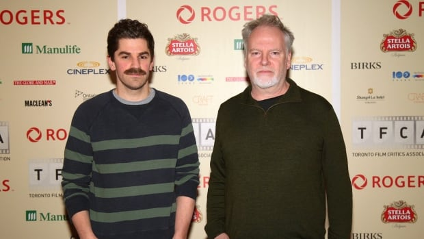 Co-directors of The Forbidden Room, Evan Johnsonl (left) and Guy Maddin arrive at the The 2015 Toronto Film Critics Association Awards in Toronto on Tuesday, Jan. 5, 2016. The film took home the $100,000 award for best Canadian film.