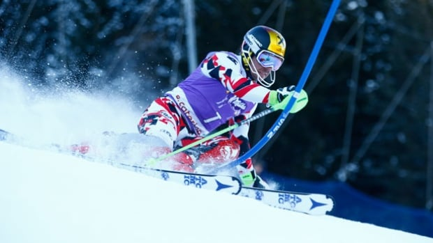 Austria's Marcel Hirscher clears a gate en route to winning the men's slalom race at Santa Caterina Valfurva, Italy.