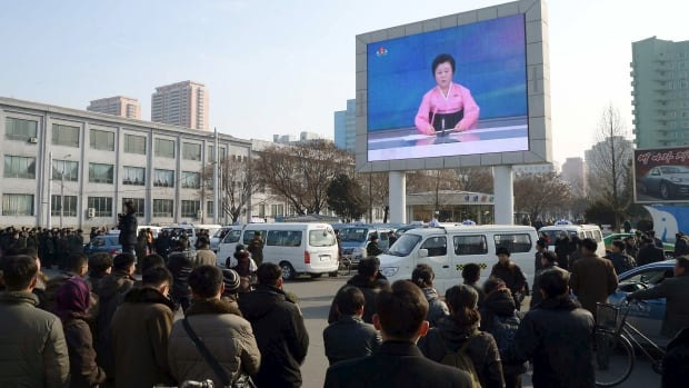 People in Pyongyang watch a huge screen broadcasting the North Korean government's announcement of a 'miniaturized' hydrogen bomb test, which officials called a 'perfect success.' Outside experts have been skeptical about North Korean claims about H-bombs, which are much more difficult to make than atomic bombs.