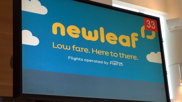 A sign for NewLeaf Travel Company at James Armstrong Richardson International Airport in Winnipeg. The discount airline has had to postpone its plans to begin operations in February.
