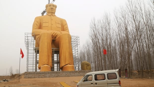 Entrepreneurs invested nearly 3 million yuan ($460,000 US) to build this 36-metre golden monument to former Chinese leader Mao Zedong in rural China. But as the currency falls, money is looking for safer investments abroad.