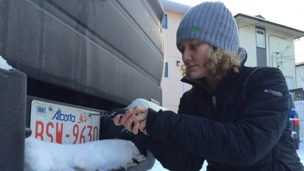 Erin LInn now uses special, anti-theft screws  after her license plate was stolen from her truck last November, and used in a gas station theft.