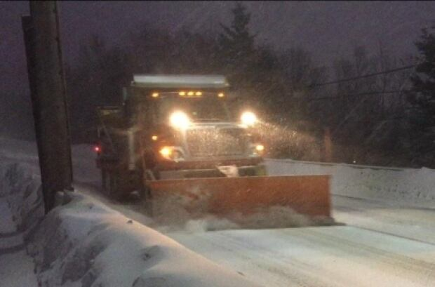 Snow plough at night