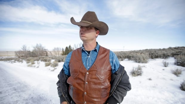 Ryan Bundy, one of the sons of Nevada rancher Cliven Bundy, speaks with a reporter at Malheur National Wildlife Refuge on Wednesday, Jan. 6, 2016, near Burns, Ore. With the takeover entering its fourth day Wednesday, authorities had not removed the group of roughly 20 people from the Malheur National Wildlife Refuge in eastern Oregon's high desert country.