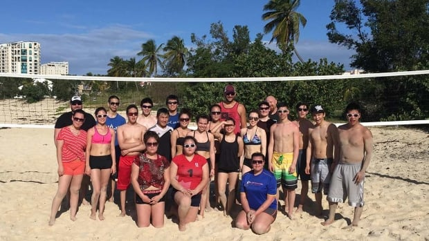 Nunavut's junior men's and women's teams pose for a photo in between beach training sessions. The teams are training in St. Maarten in the Caribbean for the 2016 Arctic Winter Games.