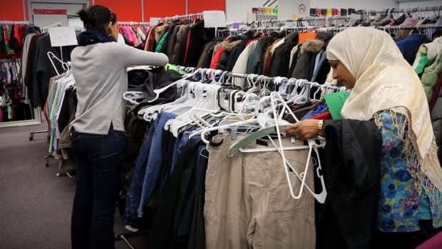 The Clothing Drive is a free store where Syrian newcomers can choose their own clothing.