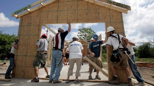 Volunteers from Habitat for Humanity raise a garage. Some retirees turn to volunteer work as a way to use their skills and energy after leaving a full-time job. Many also find they want to keep working and transition more slowly into retirement.