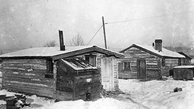 The Hunt House, at right, is Calgary's oldest building still standing in its original location.