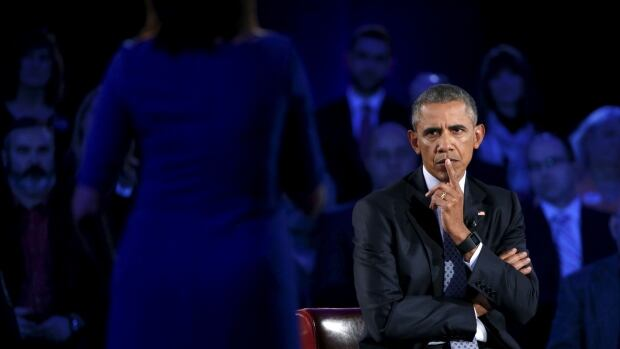 U.S. President Barack Obama listens to remarks from an audience member as he participates in a live town hall event on reducing gun violence hosted by CNN  at George Mason University in Fairfax, Va.