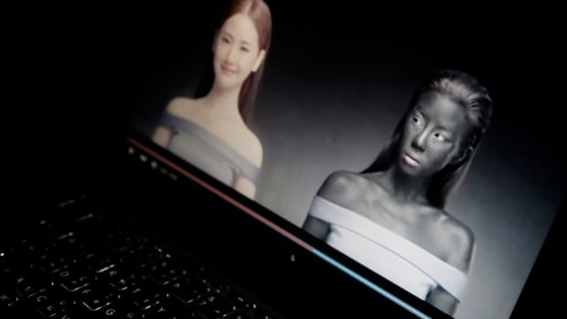 An online ad by Thai cosmetics company Seoul Secret showing Thai actress Cris Horwang is displayed on a computer screen in Bangkok, Thailand, on Jan. 8, 2016. The company has pulled a video in which the Thai movie star wears blackface and promotes a skin-whitener with the slogan: 'You just need to be white to win.' (AP Photo/Charles Dharapak)
