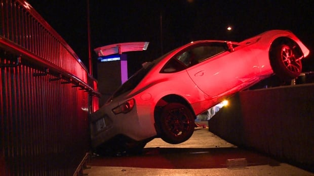 A Scion FR-S crashed over the barrier on the Lions Gate Bridge onramp, early Friday morning.