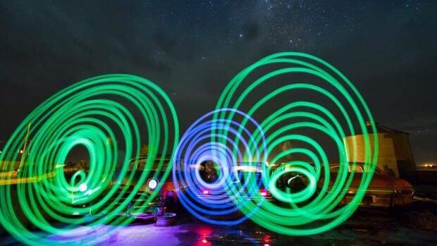 Jordan Van de Vorst and friends try 'light painting' with glow sticks.