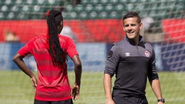 Canada's women's soccer team will open a training camp on Saturday in Vancouver. Head coach John Herdman, right, will have to cut his 23-player roster down to 20 for an Olympic qualifier next month in Texas and to 18 for this summer's Rio Olympics, should they qualify.