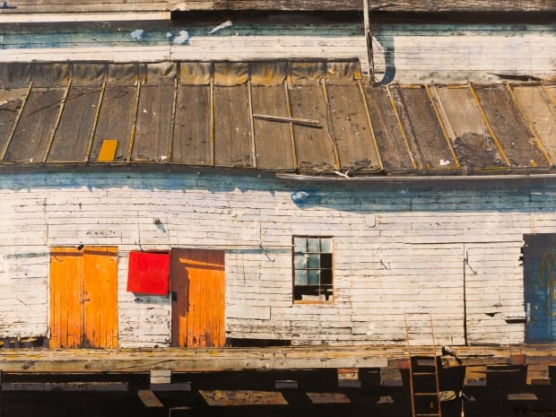 In Ghost Passages of the McKenzie Shipyard, artist Tracy McMenemy takes photos of the last day of the McKenzie Shipyard and manipulates them with a variety of artistic techniques, like this photo of a building.