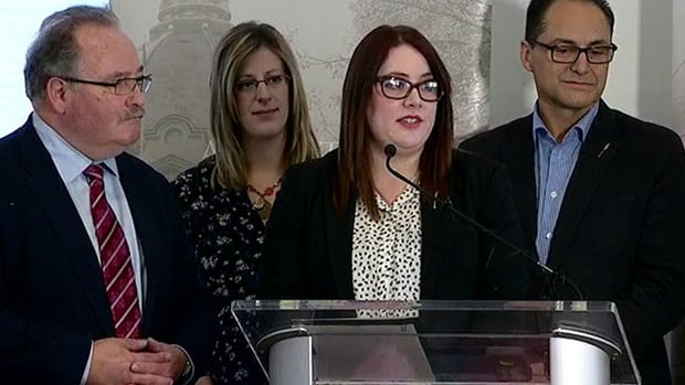Deborah Drever speaks to reporters, flanked by (from left) government house leader Brian Mason, Calgary-Varsity member of the legislature Stephanie McLean and Finance Minister Joe Ceci.