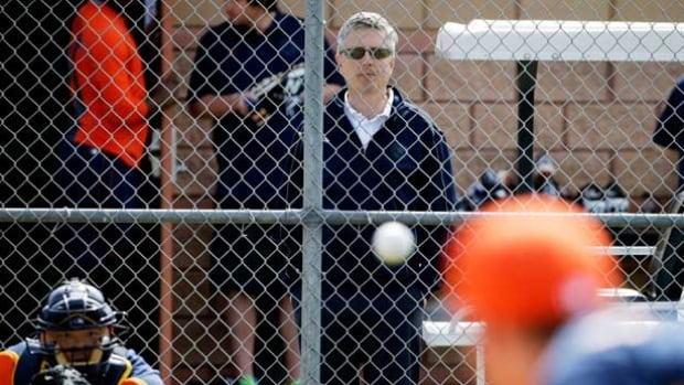 In this Feb. 21, 2015, file photo, Houston Astros general manager Jeff Luhnow, center, watches during a spring workout. The former scouting director of the St. Louis Cardinals has pleaded guilty in federal court to hacking the Houston Astros' player personnel database. Christopher Correa pleaded guilty Friday, Jan. 8, 2016, to five counts of unauthorized access of a protected computer, access authorities said dated back several years.