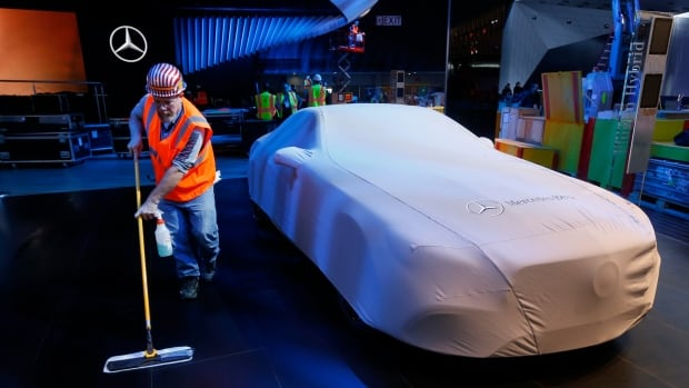 Carpenter Andy Assenmacher is seen working on the Mercedes-Benz exhibit in preparation for the upcoming North American International Auto Show in Detroit.