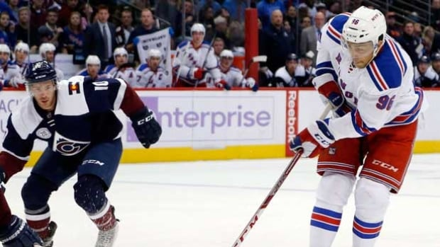 New York Rangers right wing Emerson Etem, right, was acquired by the Vancouver Canucks Friday in a trade deal.