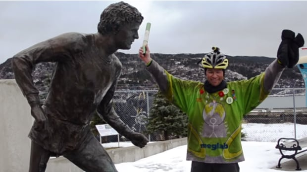 Steve O'Brien celebrates the end of his cross-Canada tour at the Terry Fox monument in St. John's, N.L.