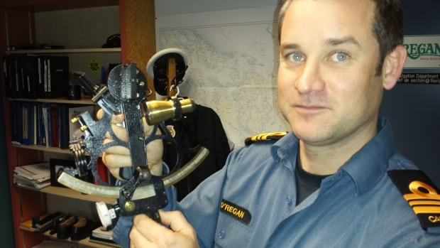 Lt.-Cmdr. Daniel O'Regan shows off his favourite piece of almost 300-year-old navigational technology: the sextant.