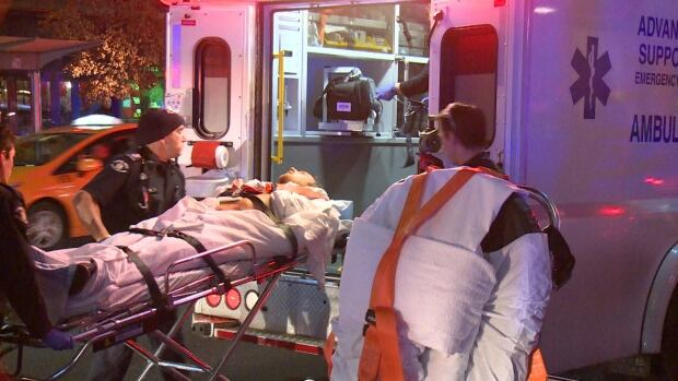 A man is loaded into a B.C. Ambulance Advanced Life Support unit, early Saturday morning.