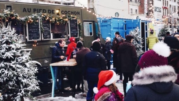 Au Pied de Cochon set up their food truck in Place des Arts during the holidays.