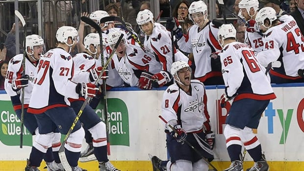 Washington Capitals forward Alex Ovechkin (8) celebrates with his teammates after scoring the game-winning goal during overtime against the New York Rangers on Saturday at Madison Square Garden in New York.