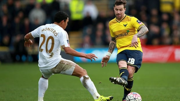 Swansea City's Jefferson Montero, left, and Oxford United's Christopher Maguire battle for the ball during their English FA Cup, third round soccer match at the Kassam Stadium in Oxford, England on Sunday.