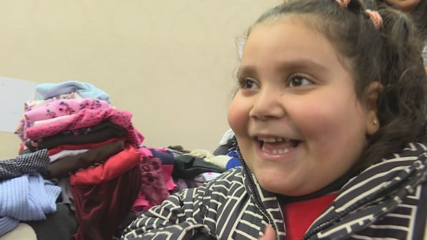 This young Syrian was fitted for her first proper winter coat at The Clothing Drive's pop-up shop in a North York Hotel.