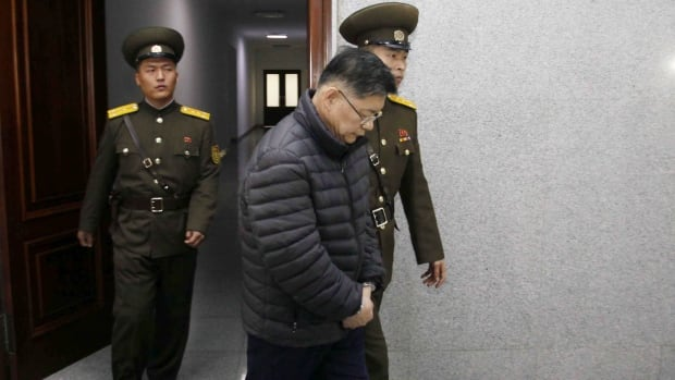 Hyeon Soo Lim from the Light Korean Presbyterian Church in Mississauga, Ont., is shown being escorted to his sentencing in Pyongyang, North Korea, on Dec. 16.