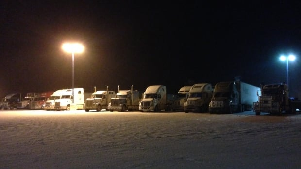 Dozens of transport trucks lined up at the Husky Truck stop in Nipigon, Ont., with the other two truck stops in town just as packed, when the bridge was shut Sunday.