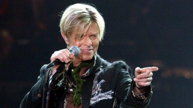 David Bowie is shown performing on stage during a concert in Hamburg, Germany in October 2003. Bowie died Jan. 11 after a battle with cancer. (Maurizio Gambarini/EPA)
