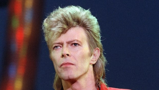 British singer David Bowie performs on stage during a concert in La Courneuve on July 3, 1987.