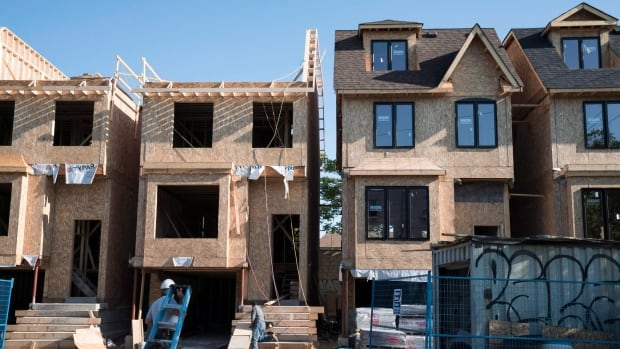Houses are seen under construction in Toronto last summer. 2015 was a solid year for housing starts across the country, despite a soft December.