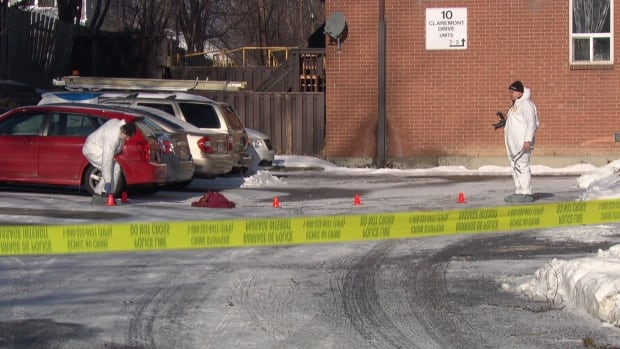 Investigators collect evidence at the scene of Ottawa's first homicide of 2016 on the morning of January 11, 2016.