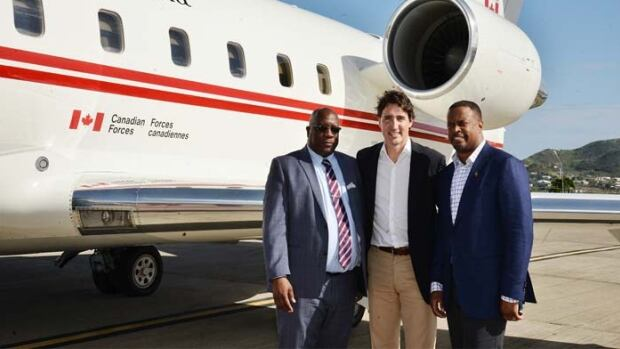 When Prime Minister Justin Trudeau, centre, wrapped up a vacation in St. Kitts and Nevis, a local newspaper ran this photo of him being seen off by Prime Minister Dr. Timothy Harris, left, and Mark Brantley, foreign affairs minister for St. Kitts and Nevis.